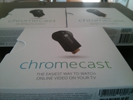A photo of several Google Chromecast boxes