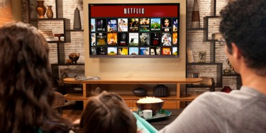 Photo of family watching Netflix