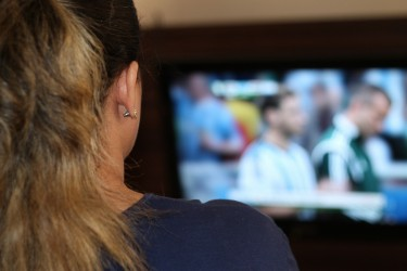 Photo of a woman, watching TV