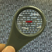 Image showing binary code magnifying glass showing password