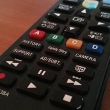 A photo of a Samsung Smart TV remote control